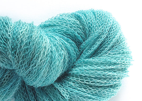 Hand-painted unusual 100% alpaca tubular-knit yarn in Aquamarine