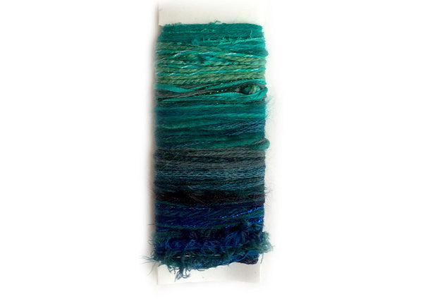 Scraplet Skeins multi-textured hand-tied art yarn in Blue Christmas