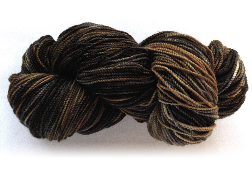 Hand-painted Superwash wool sock-weight yarn in Bronze Age (brown/bronze/charcoal/black)