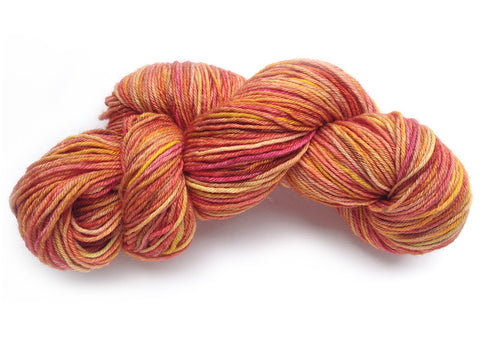 Hand-painted, luxury merino/silk/alpaca sport-weight yarn in Fire Poppies (deep orange-reds/coral/pink/bronze))
