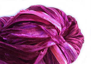 Hand-painted, soft, shiny novelty ribbon yarn in Heartbeat
