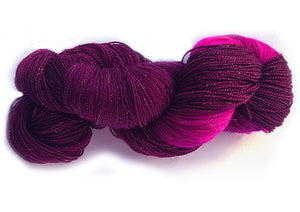Hand-painted, sparkly merino/silk sock-weight yarn in Heartbeat