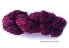 Load image into Gallery viewer, Hand-painted, sparkly merino/silk sock-weight yarn in Heartbeat