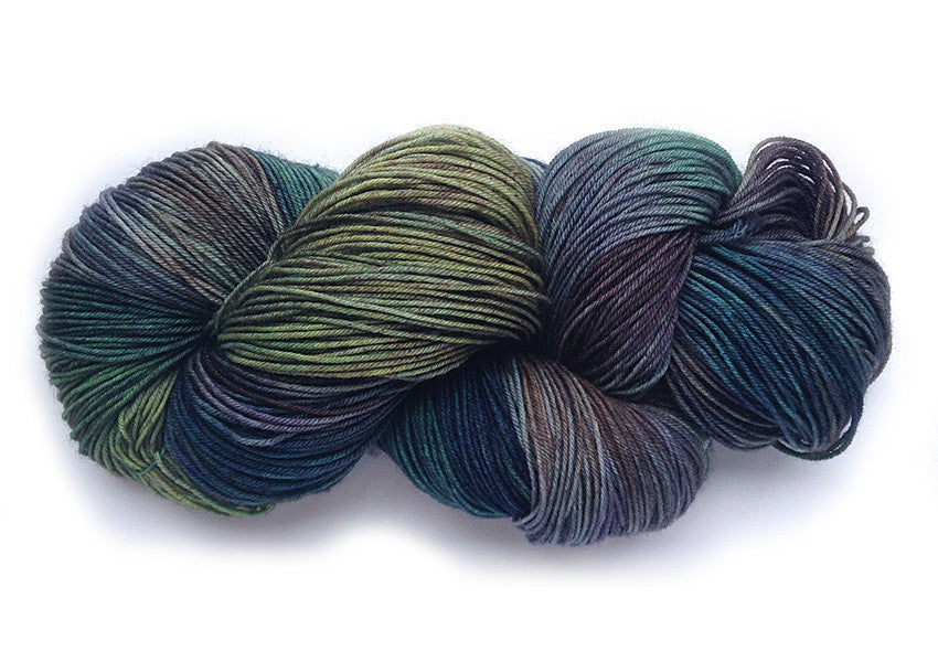 Hand-painted, Superwash merino wool sock-weight yarn in Labradorite (deep blue-greens, muted violet, greys)