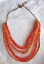 Load image into Gallery viewer, Multi-strand Art-Yarn Necklace in Orange Zest (orange/peach/coral), with Crystal Embellishment