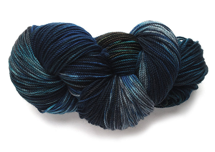 Hand-painted Superwash wool-blend sock-weight yarn in Oregon Coast (Dark Version)