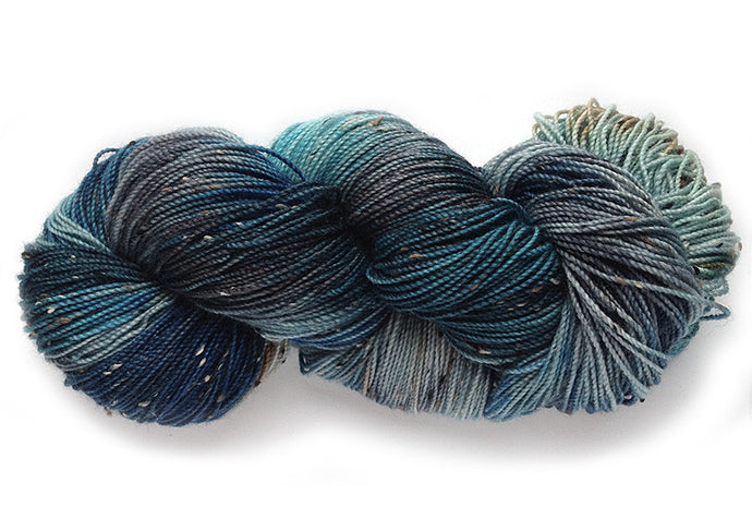Hand-painted tweedy Superwash Merino wool sock-weight yarn in Oregon Coast (Dark Version)