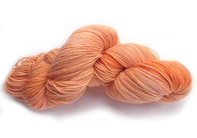 Load image into Gallery viewer, Hand-painted, luxury merino wool/silk sparkly sock-weight yarn in Peach Flamingo (peach/coral/pale pink)