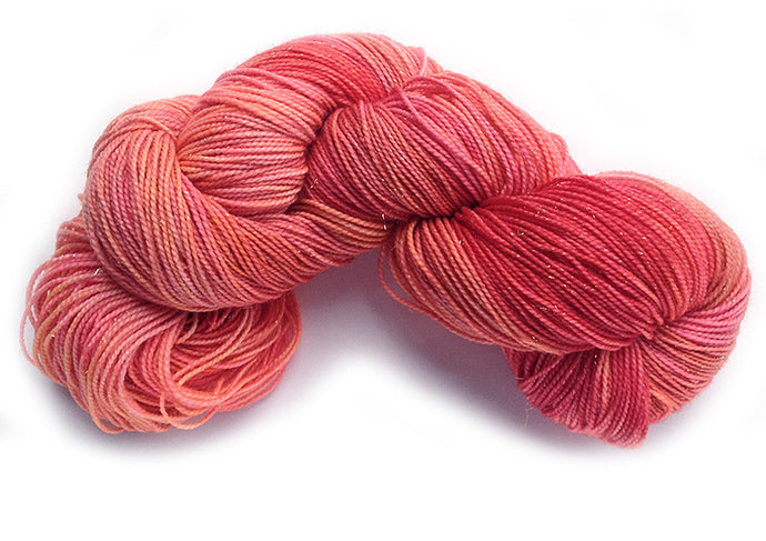 Hand-painted, luxury merino wool/silk sparkly sock-weight yarn in Pink Flamingo (coral/pink/deep orange-red)
