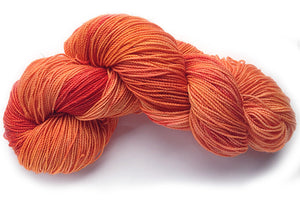 Hand-painted, luxury merino wool/silk sparkly sock-weight yarn in Red Flamingo (deep orange-reds/coral/pink))