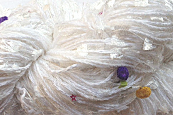 Signature Skeins multi-strand art yarn in Iced Cherries (whites with bright accent colors)