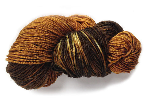 Hand-painted Superwash merino wool worsted-weight yarn in Tiger's Eye