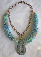 Load image into Gallery viewer, Multi-textured Art-Yarn Necklace in Turquoise (blue-greens), with Verdigris Pendant & Crystals