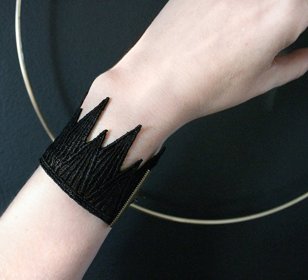 black lace cuff joined with antiqued brass hardware