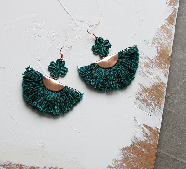 bohemian fan earrings, made of fringe and lace.