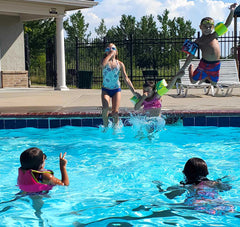 kids jumping into a pool