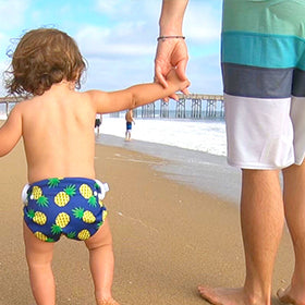 Dad and baby in beau and belle littles swim diaper connecting together on the beach in California