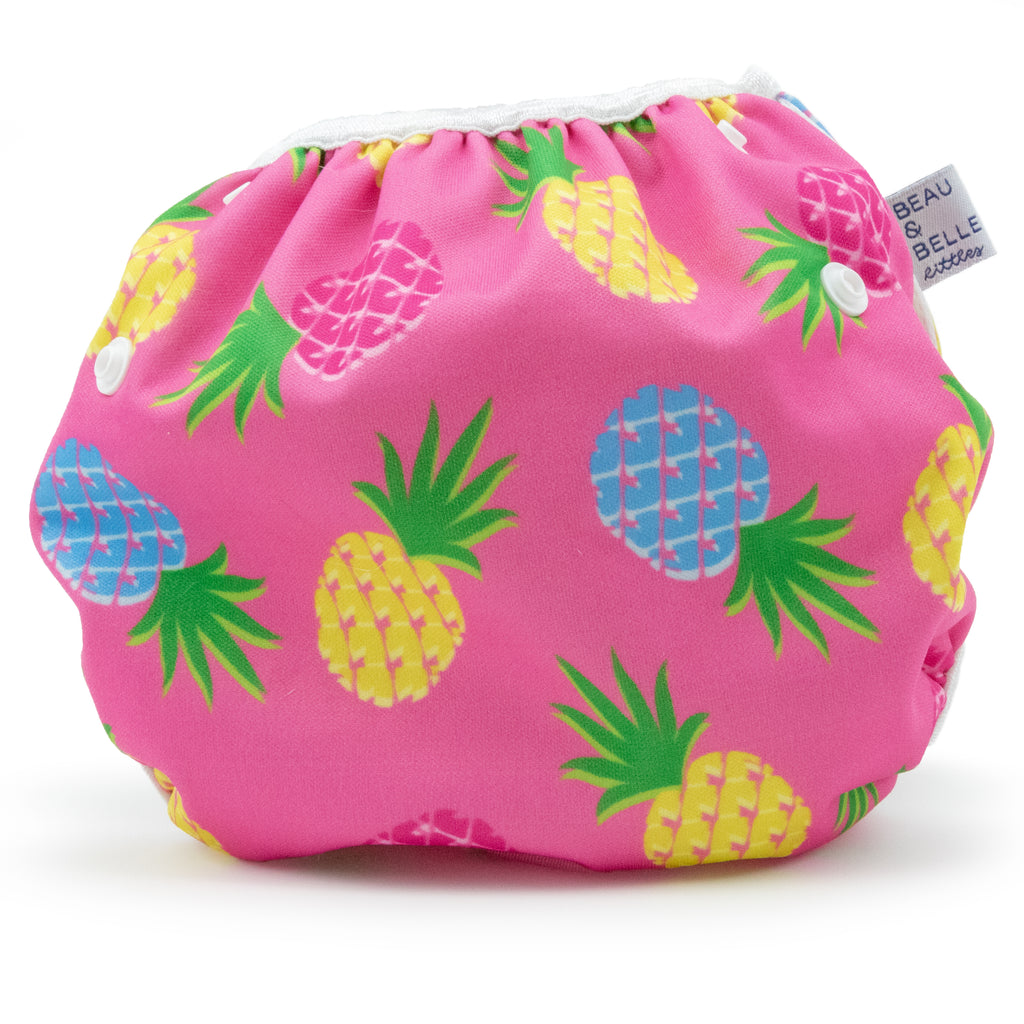 Beau and Belle Littles Swim Diaper, Large Size, light pink background with yellow, dark pink, and blue pineapples, back view