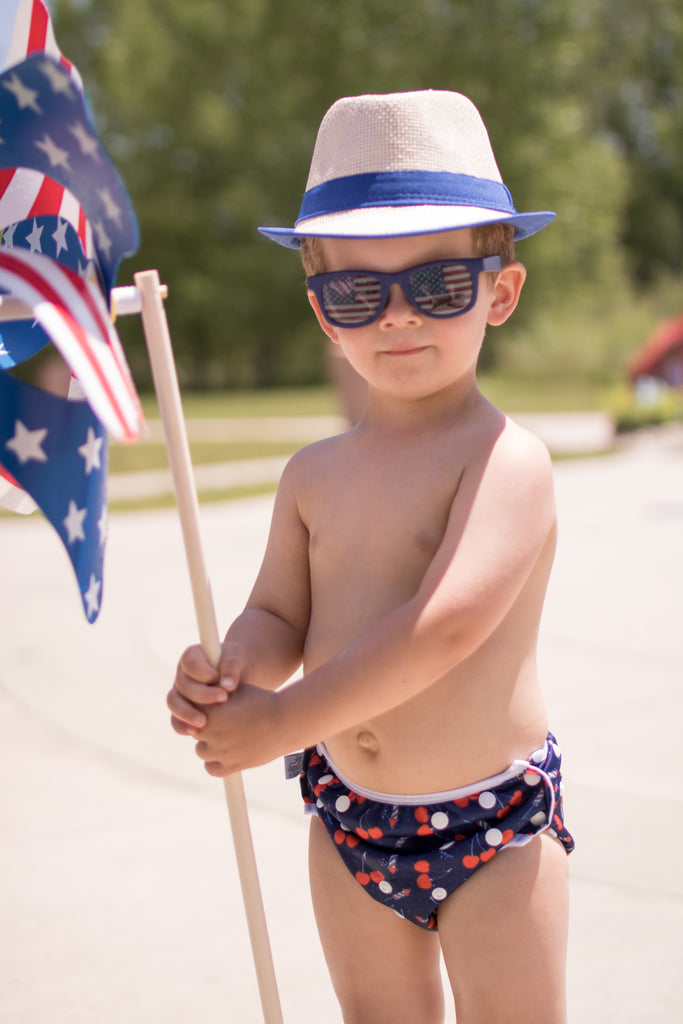 little boy wearing a hat, sunglass and a Beau and Belle Littles Swim Diaper, Regular Size, Lauren Holiday Cherry bomb print