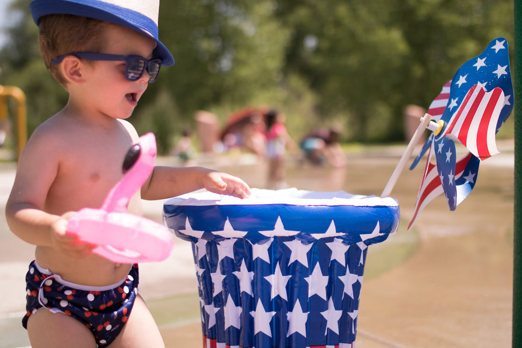 little boy wearing a hat and sunglasses and Beau and Belle Littles Swim Diaper, Regular Size, Lauren Holiday Cherry bomb print