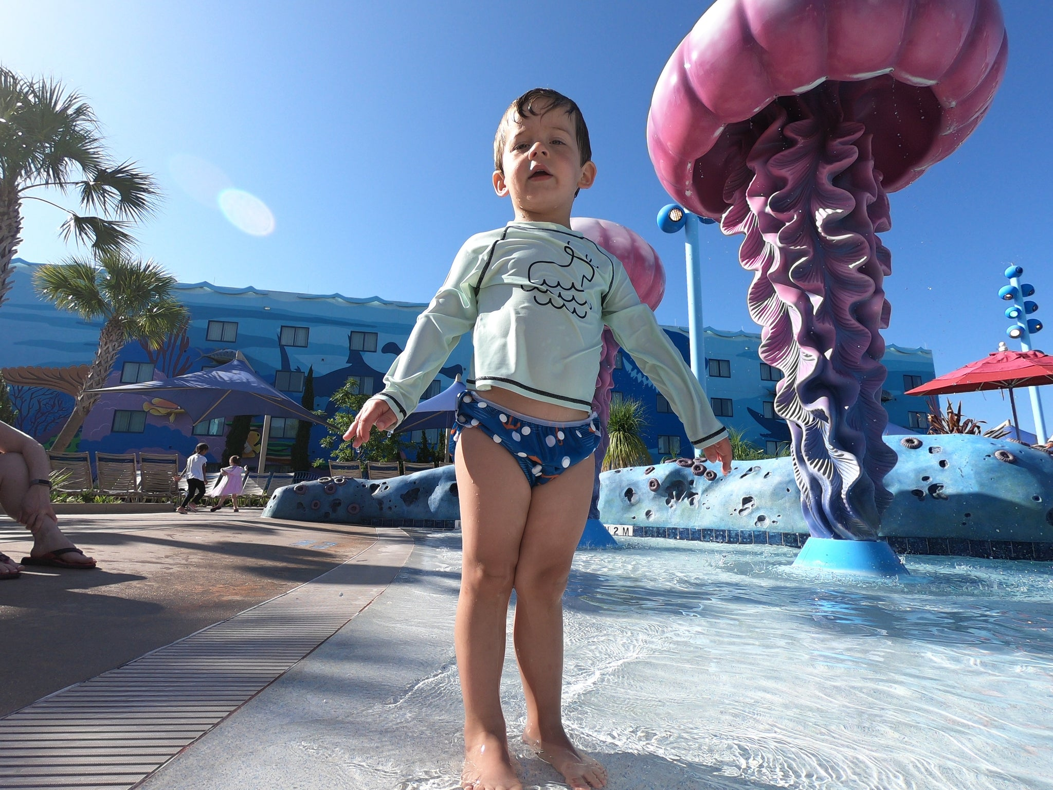 boy at a splash pad wearing Beau and Belle Littles Swim Diaper, Large Size, Anchor print