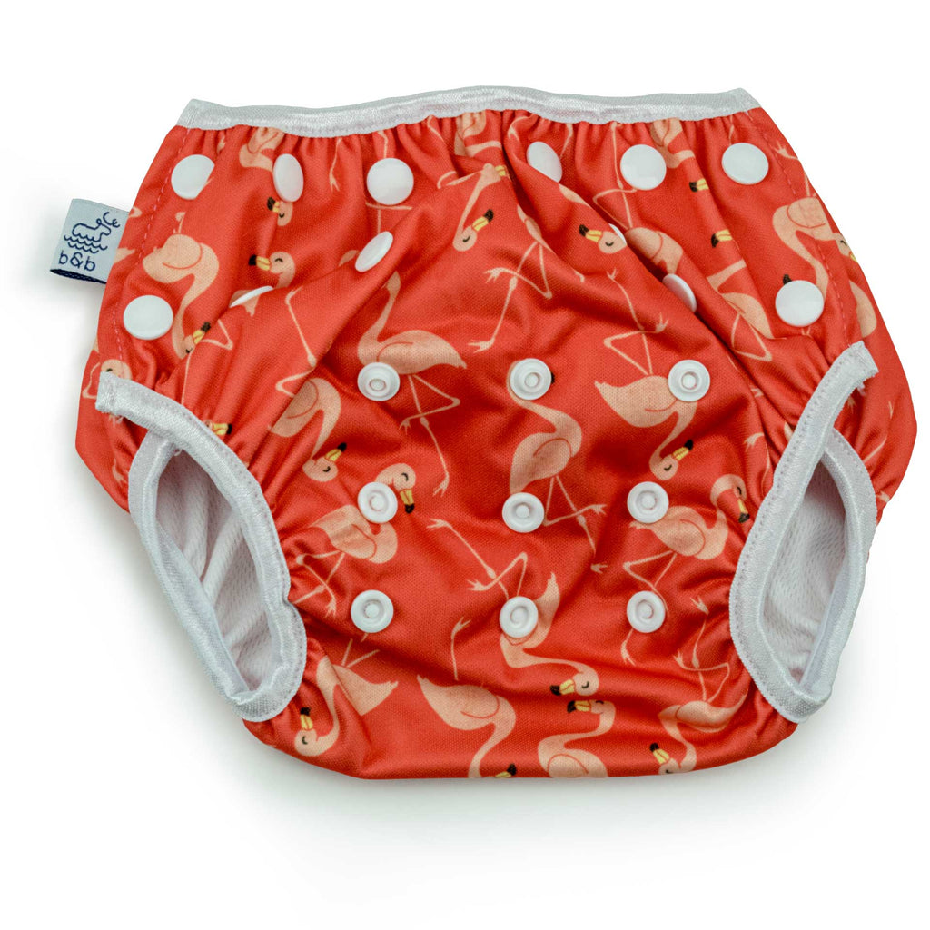 Beau and Belle Littles Swim Diaper, Regular Size, dark pink with light pink flamingos, front view, flat lay