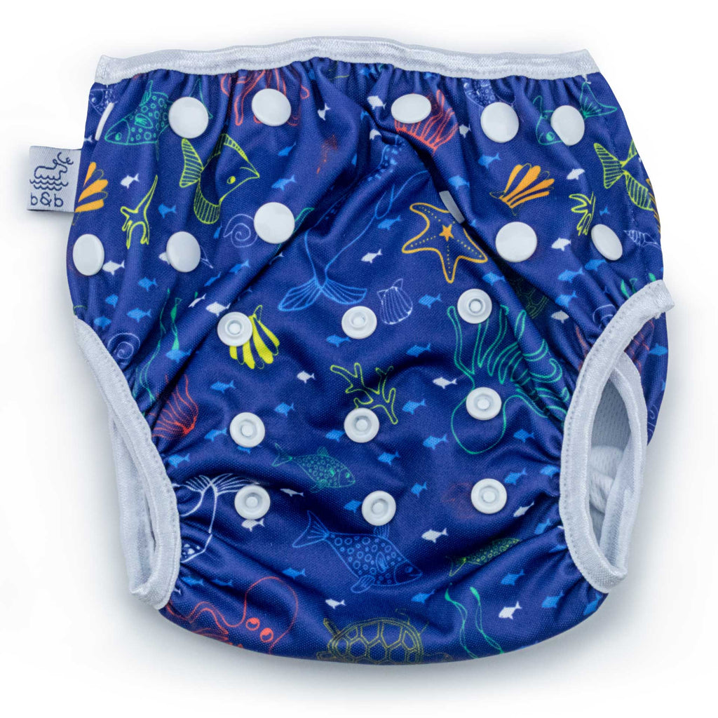 Beau and Belle Littles Swim Diaper, Regular Size, dark blue with outlines of sea creatures, Sea Friends print, flat lay, front view