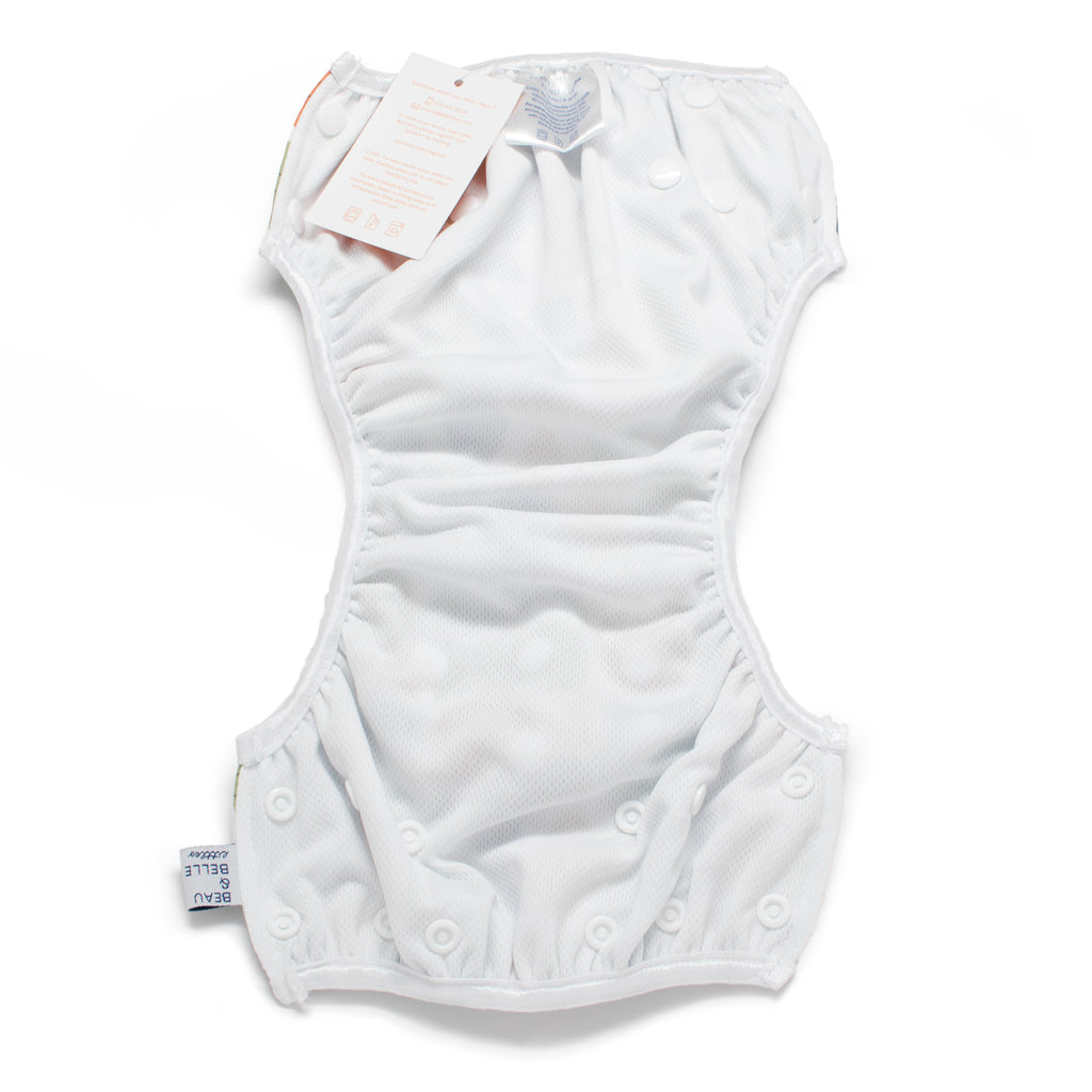 Beau and Belle Littles Swim Diaper, Regular Size, fish print, unbuttoned and laid flat to show the inner lining