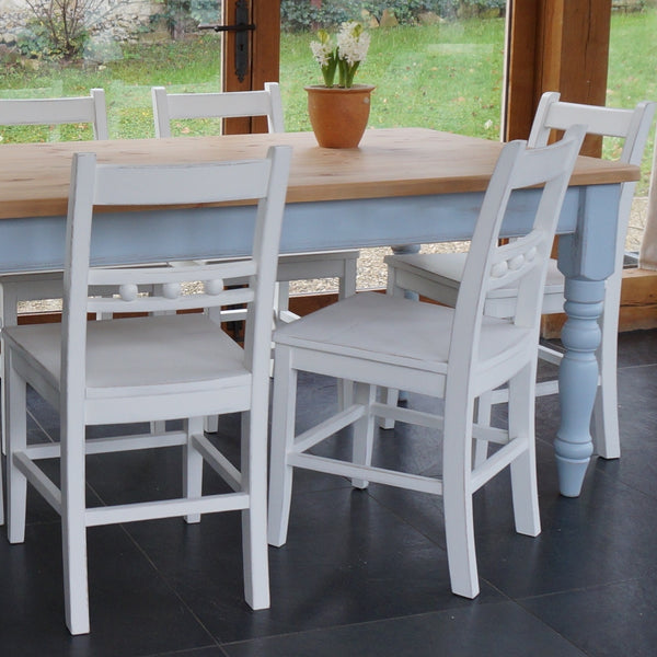 farmhouse table and ball back chairs
