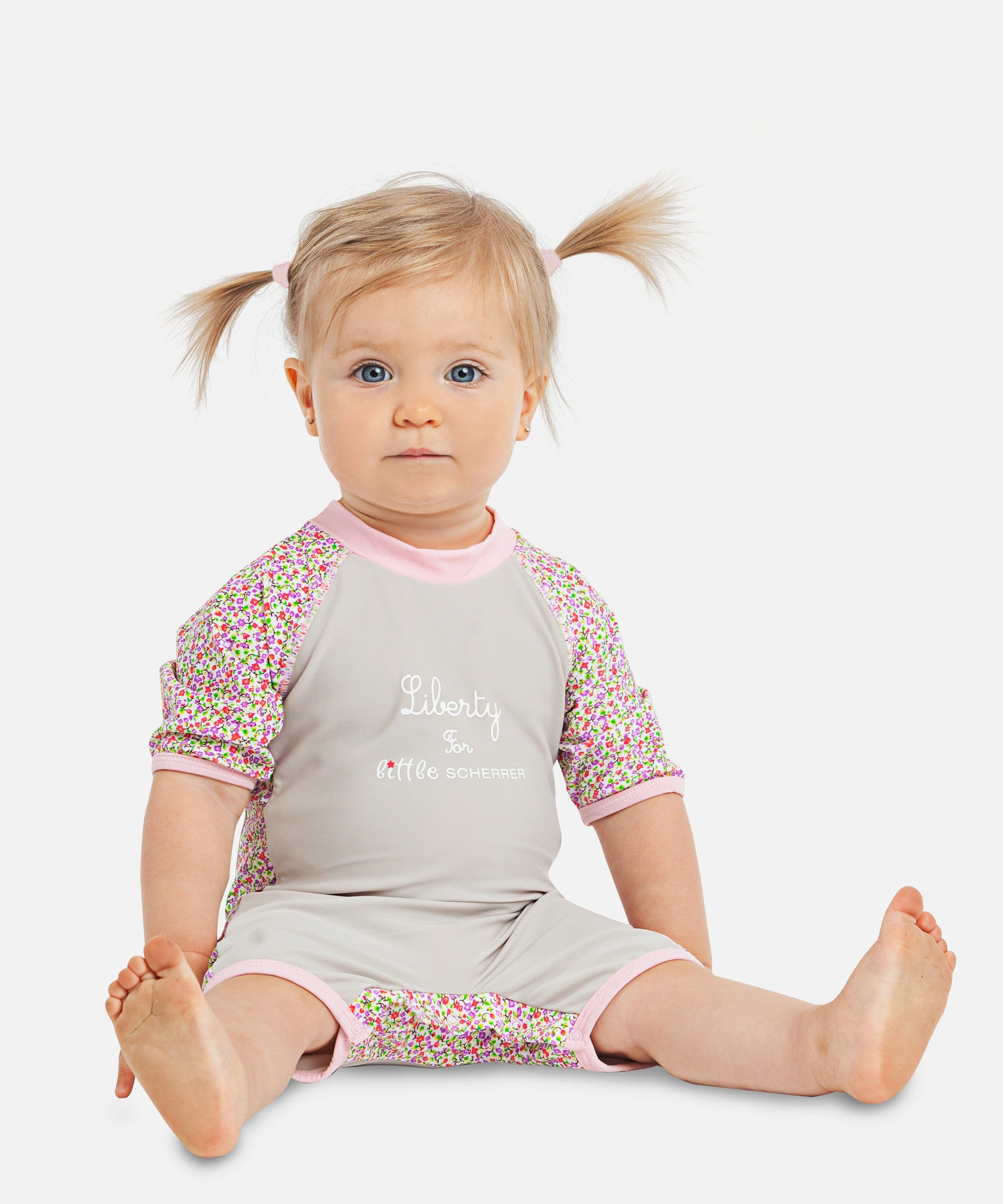 Adorable girls UV one-piece Sunsuits with a skirt by Elly la Fripouille. Comfortable and quick drying, this baby swimwear line is cute, girly and UPF50+.