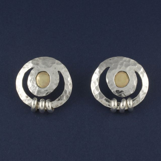 silver and gold earring round