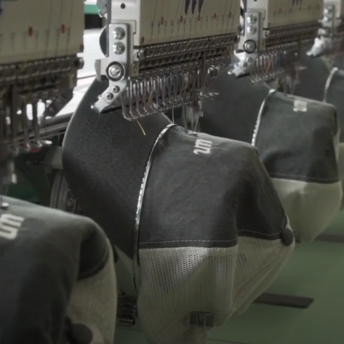 How we embroider custom hats on our 6 head embroidery machine (Video Tutorial)