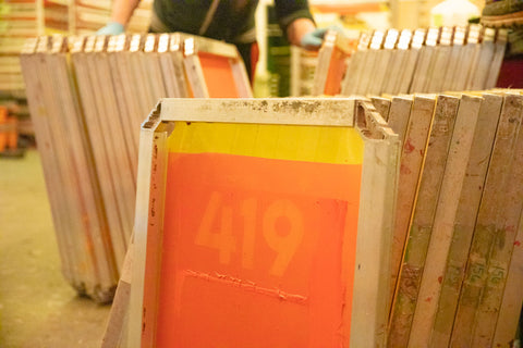 used screen printing screens stacked together