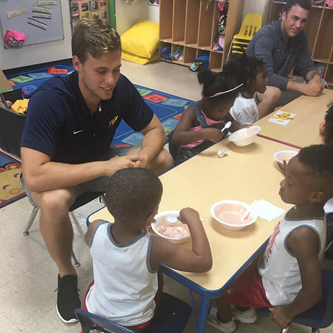 Bailey Flint having ice cream sundays with children at My First Days Daycare