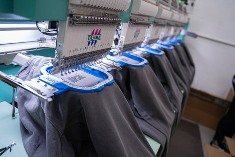 Jupmode custom embroidered sweatpants on the embroidery machine
