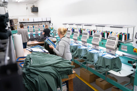 Busy with embroidery! Two embroidery machines to help with custom embroidery and retail