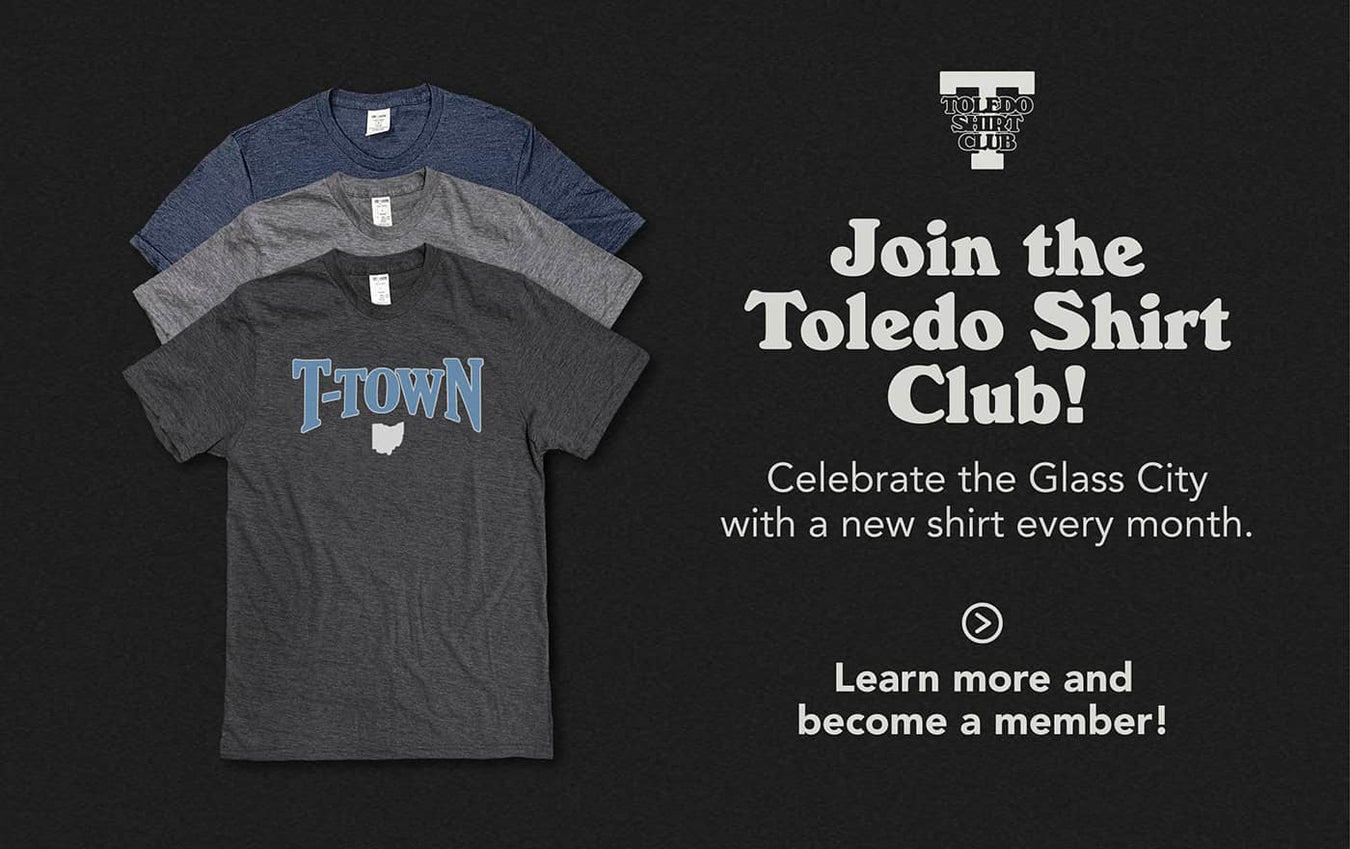 "Join the Toledo Shirt Club! Celebrate the Glass City with a new shirt every month. Learn more and become a member! Image: Three shirts stacked atop one another, with the shirt on top reading ""T-Town"" in light blue & white with the state of Ohio beneath it"