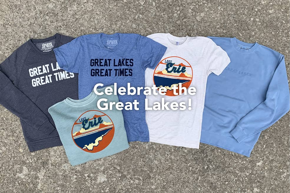 """Celebrate the Great Lakes!"" atop a photo of a Great Lakes Great Times sweatshirt & t-shirt, a Lake Erie tshirt, an embroidered tone-on-tone bright blue Great Lakes sweatshirt and a Lake Erie aqua corded sweatshirt."
