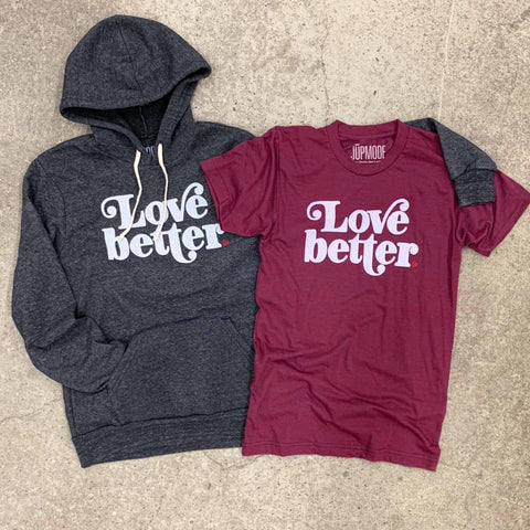 black hoodie and maroon t-shirt that say love better
