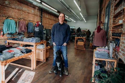 john amato and his dog penny in the jupmode retail store