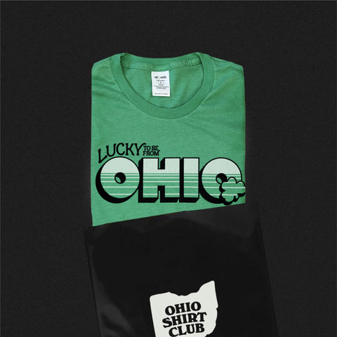 lucky to be from ohio t-shirt being placed in to an ohio shirt club envelope