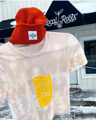 tie dye loots roots juice company shirt and beanie in front of their store