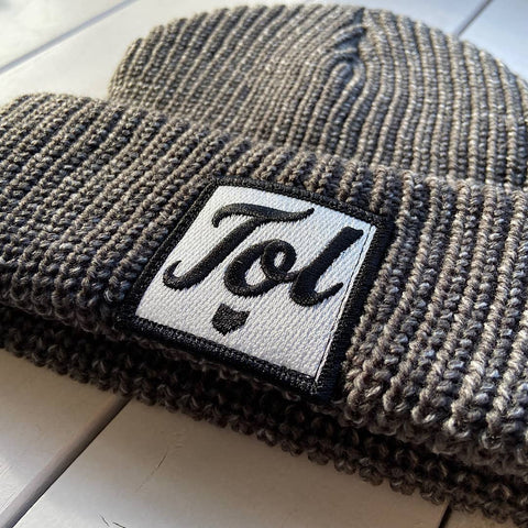 beanie with a patch on it with a scrip tol font and the shape of the state of ohio underneath