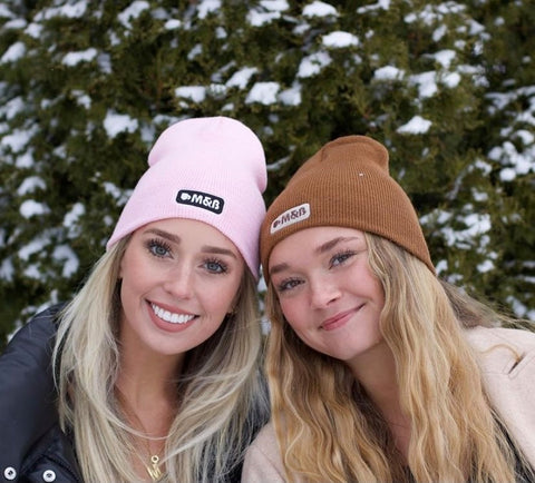 two women wearing maddie and bella coffee beanies