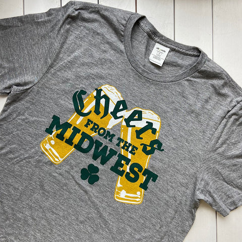 vintage gray t-shirt that says cheers from the midwest on it with shamrocks and beer glasses