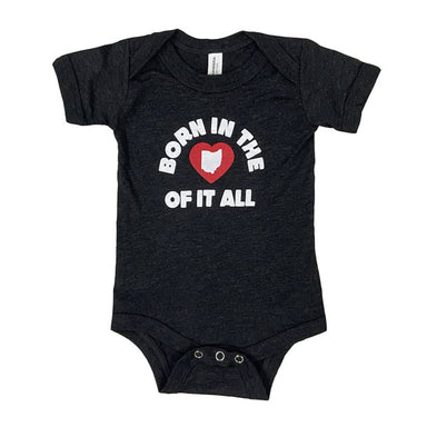 Short sleeved heather black baby onesie that says Born in the Heart of it All in white with a heart heart in the center.
