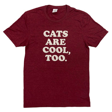 "Short sleeved burgundy shirt with ""Cats are cool, too."" in cream in on center chest."