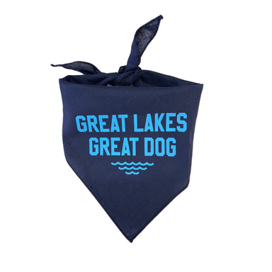 "Navy triangular dog bandana with ""Great Lakes Great Dog"" in blue with blue waves beneath the text"