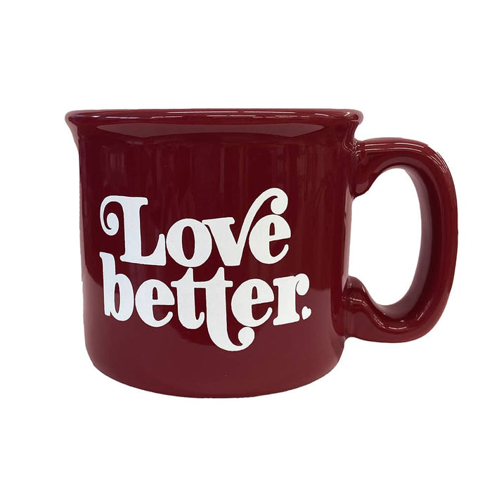 "Burgundy mug with ""Love Better"" in white ink on front."