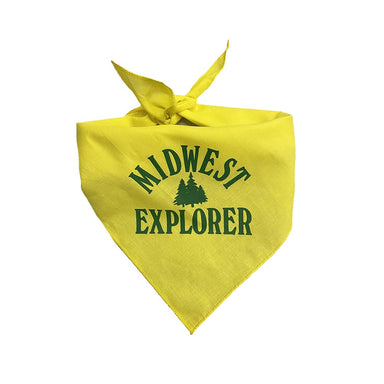 "Yellow triangular dog bandana with ""Midwest Explorer"" and a set of pine trees in dark green printed in center"